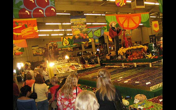 Fairgoers enjoy a colorful display of the county's bountiful harvest. Big Fresno Fair, Fresno