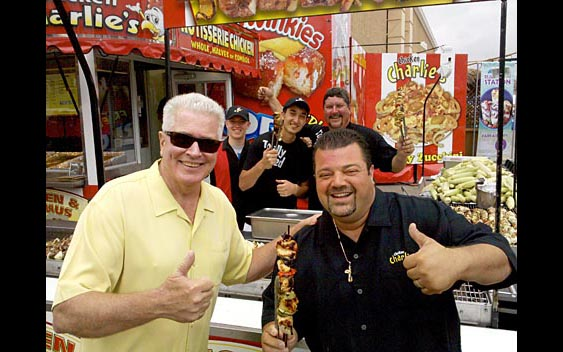"Huell Howser and ""Chicken"" Charlie Boghosian enjoy some delicious fair food. San Diego County Fair, Del Mar"