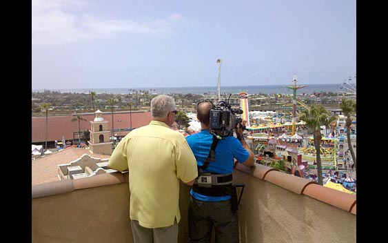 Huell Howser and cameraman take in the spectacular view from the roof of the grandstand. San Diego County Fair, Del Mar