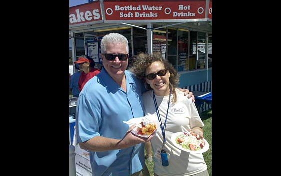 Huell Howser and fairgoer enjoy a sweet treat. Marin County Fair & Exposition, San Rafael
