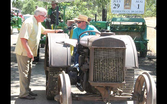 Huell Howser learns about tractors. Amador County Fair, Plymouth