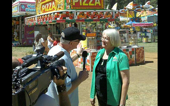 Huell Howser interviewing fair CEO Sandy Woods. Nevada County Fair, Grass Valley
